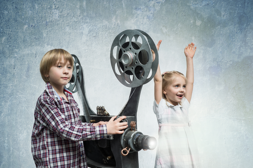 Girl and boy with a film projector